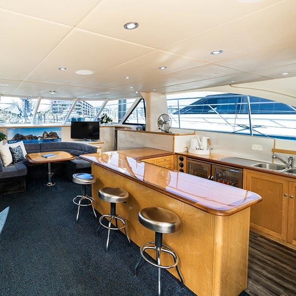 Main saloon interior of Savoy luxury boat charter