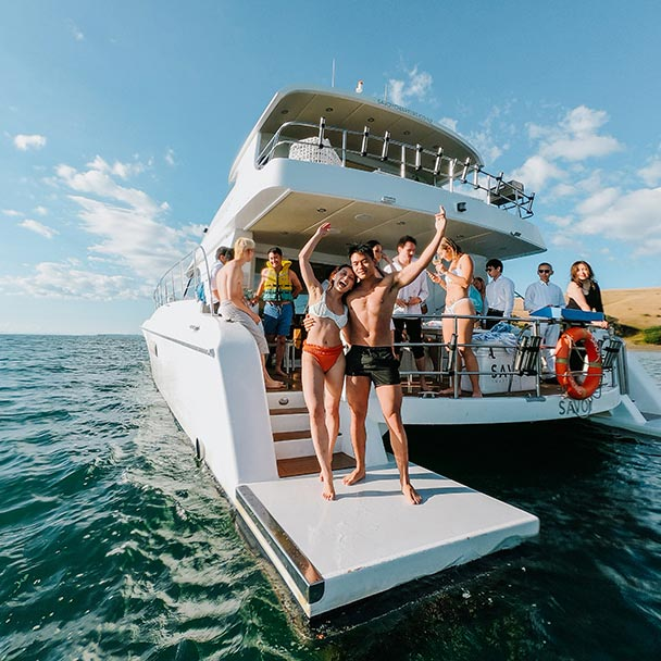 A group of young people celebrating an engagement on savoy luxury private charter boat